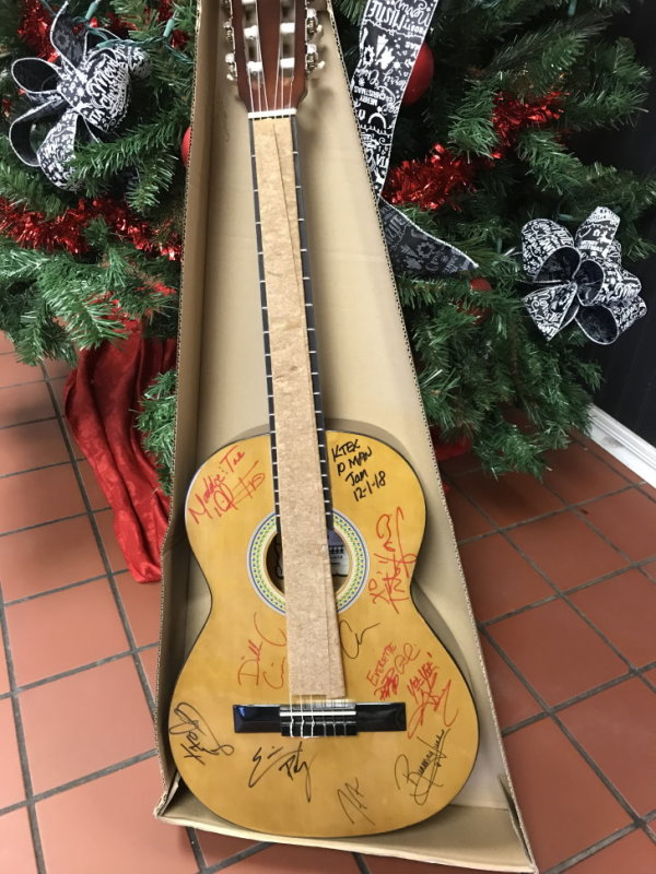 None - Register to win a Autographed Ten Man Jam Guitar!
